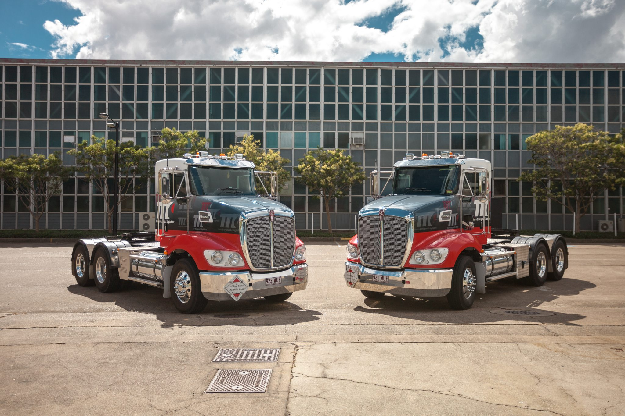 Two Team transport and logistics Identical small trucks parked