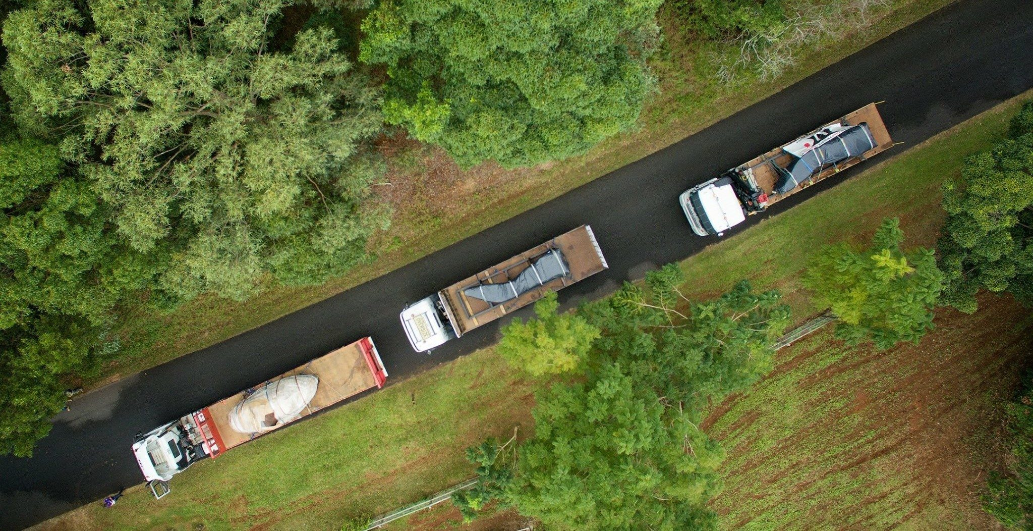 Aerial shot of trailer running on the road